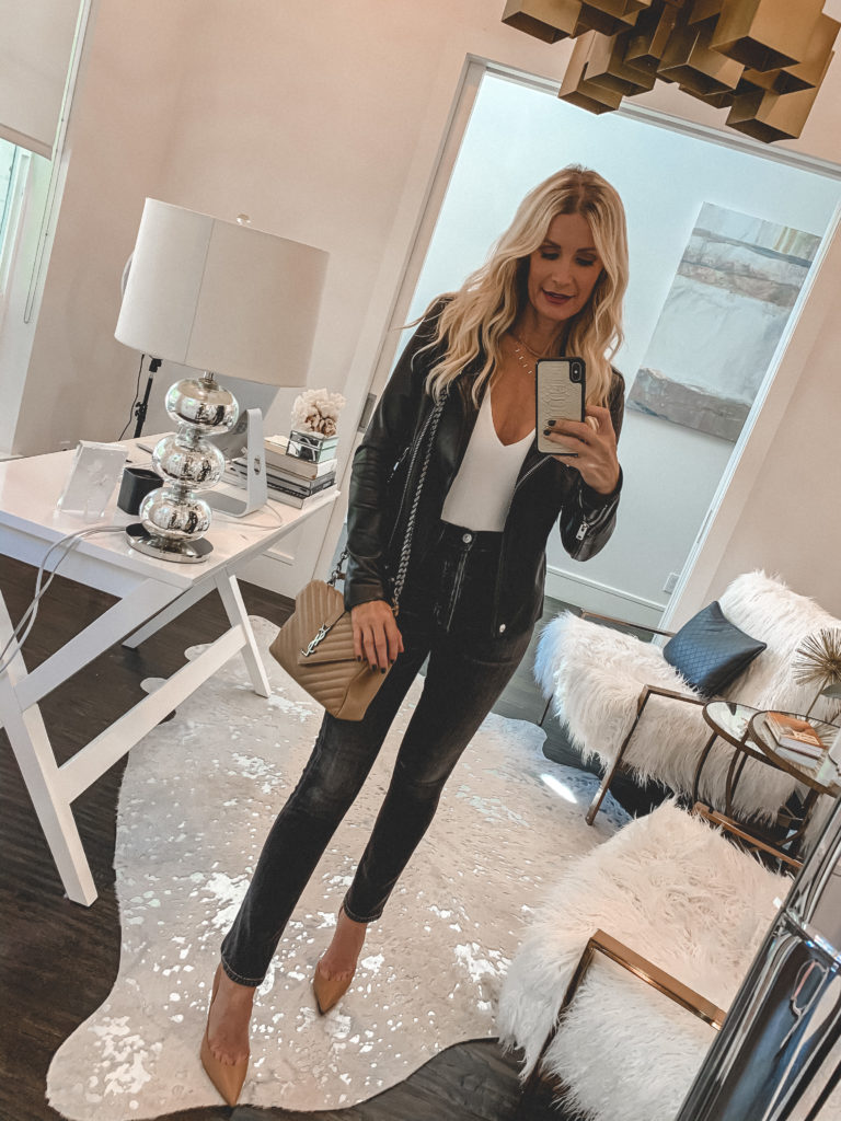 Dallas blogger wearing an Iro leather jacket and a white bodysuit