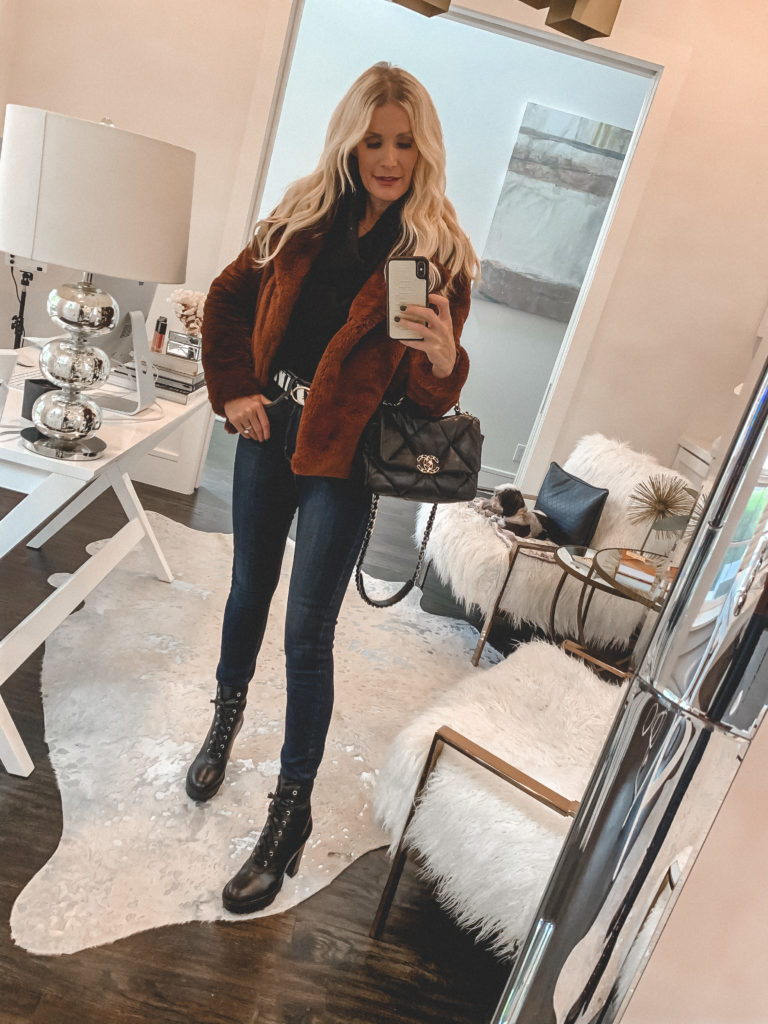 Fashion blogger wearing a rust faux fur jacket and dark denim with combat boots