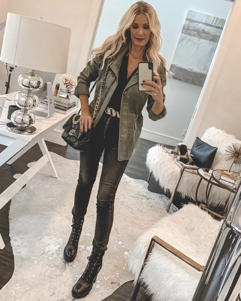 Dallas blogger wearing an army green jacket and faded black denim