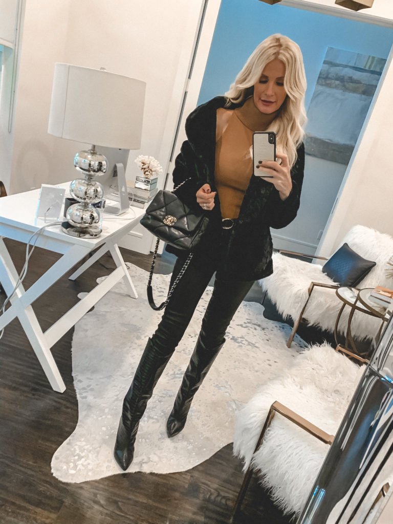Dallas fashion blogger wearing a faux fur black jacket and a rust turtleneck sweater for fall