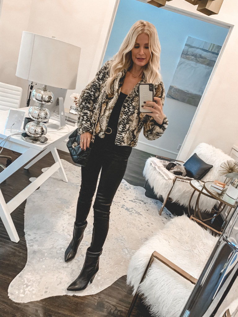 Style blogger wearing a faux fur jacket and black jeans and booties for Thanksgiving Day