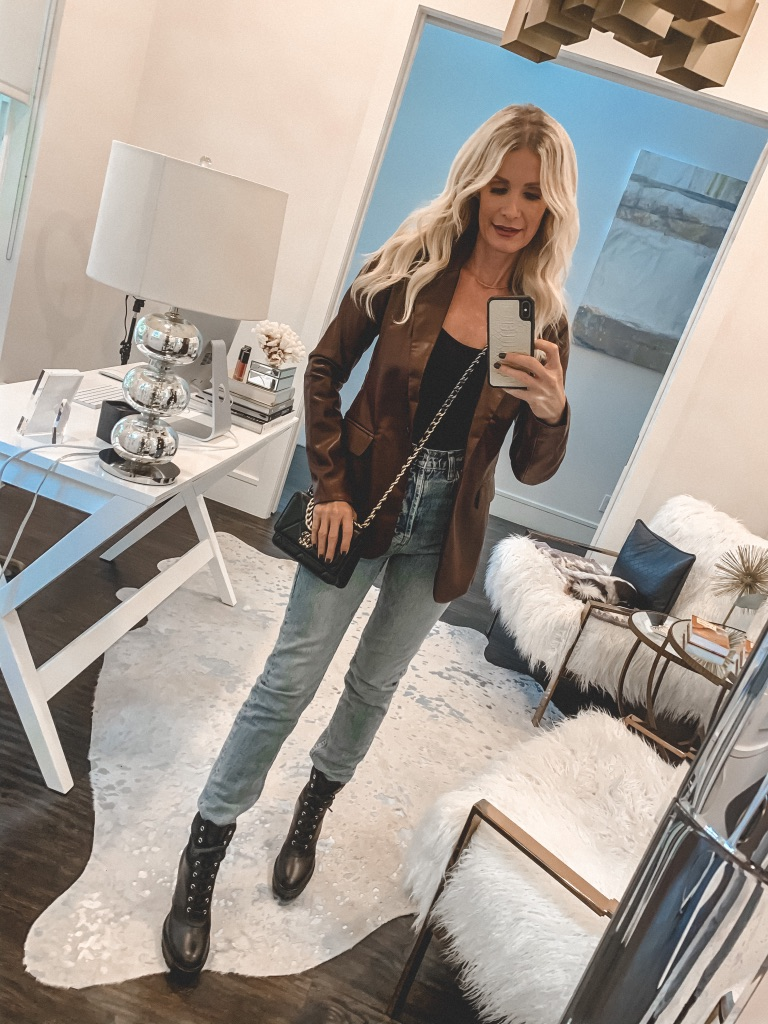 Dallas blogger wearing a brown leather blazer and denim with combat boots