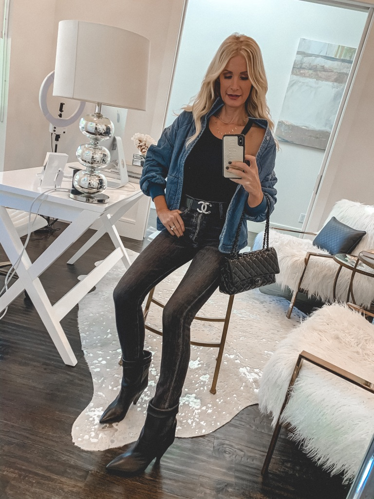 Dallas fashion blogger wearing black jeans and a Chanel belt with black booties