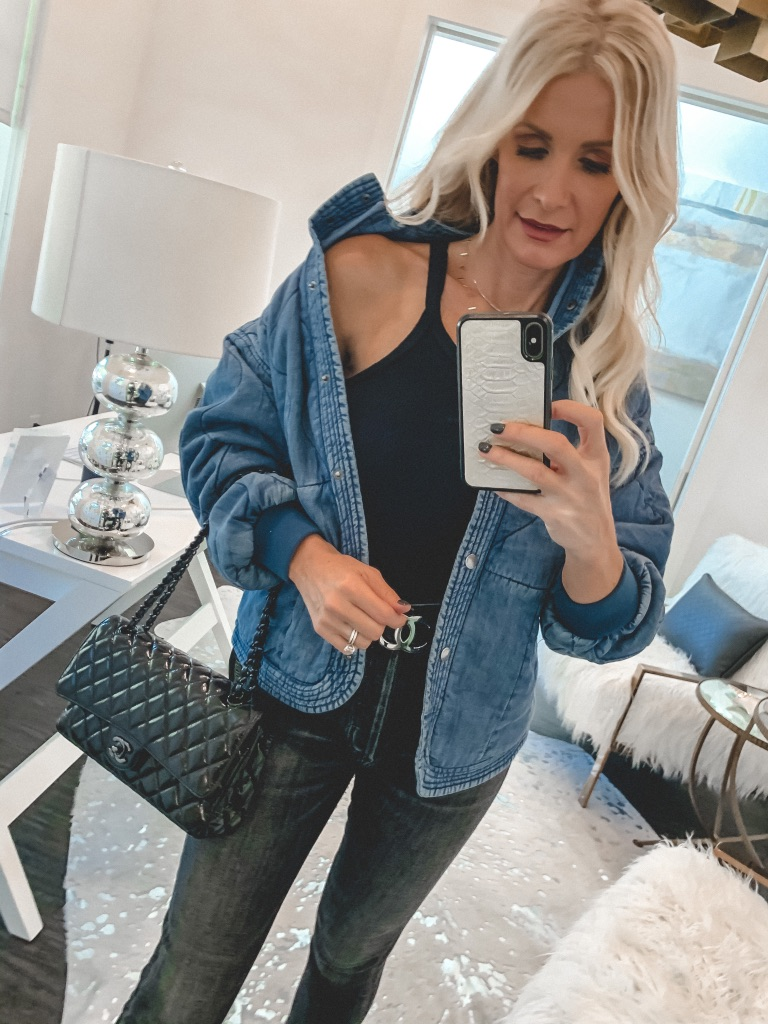 Fashion blogger wearing a quilted denim jacket and a re/done black tank