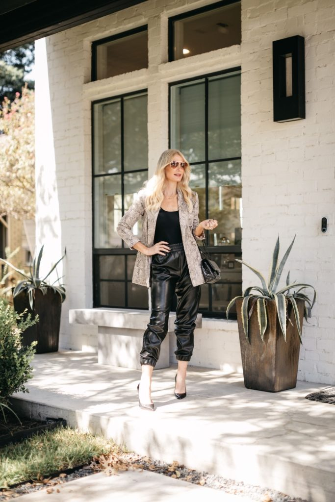 Dallas fashion blogger wearing black faux leather joggers and a black bodysuit