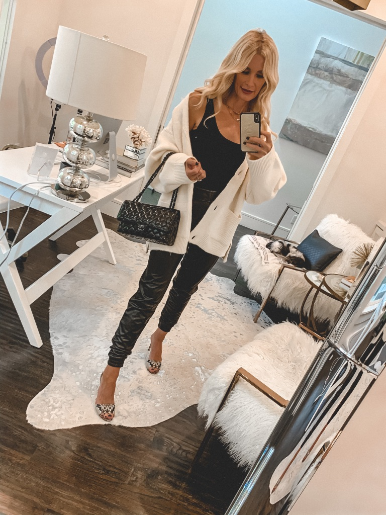 Dallas style blogger wearing faux leather pants and a white cardigan for fall and winter