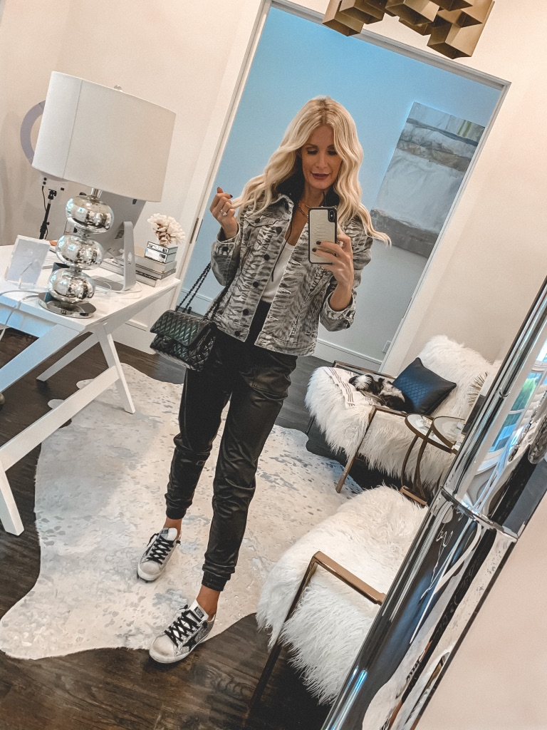 Dallas blogger wearing a tiger print jacket and faux leather joggers for a casual fall and winter look
