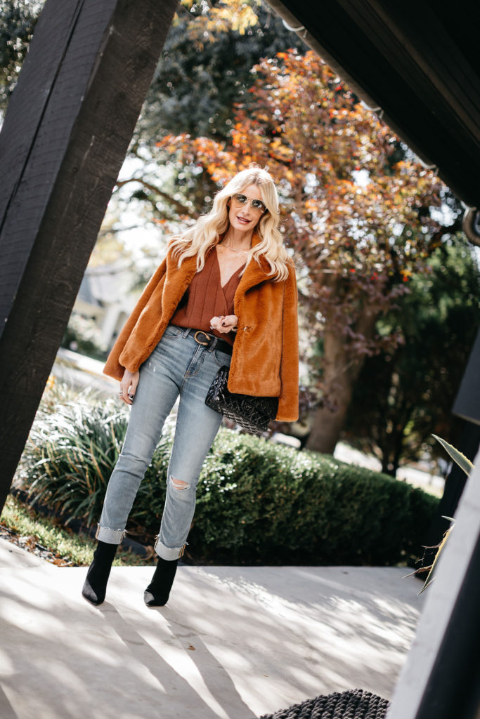 Dallas style blogger wearing a rust faux fur jacket and a brown sweater