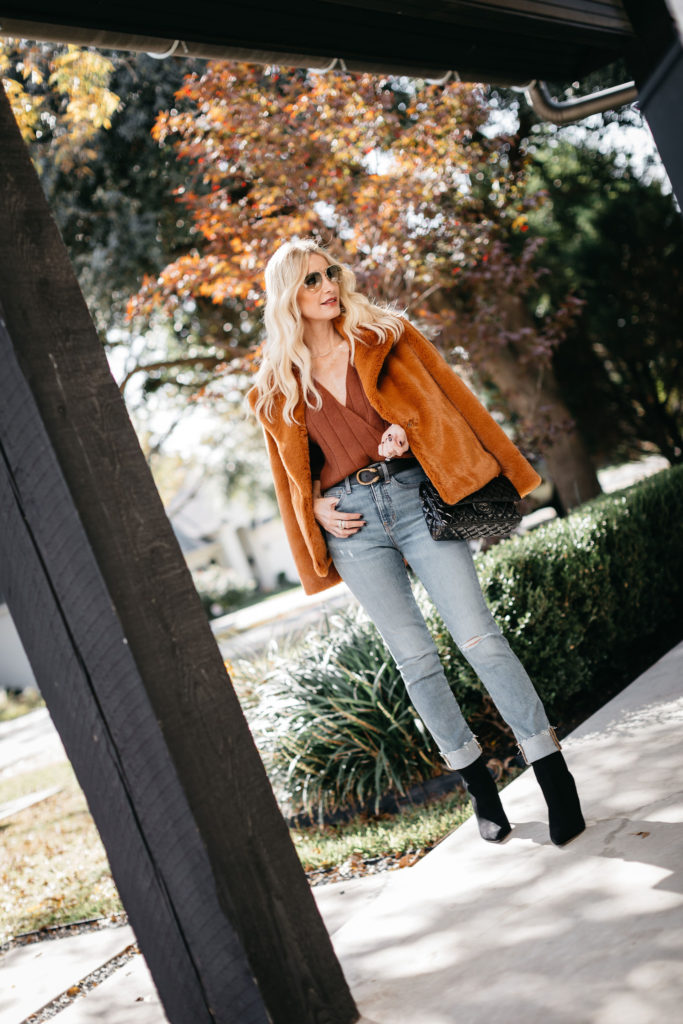 Dallas fashion blogger wearing a rust colored faux fur jacket and light wash denim