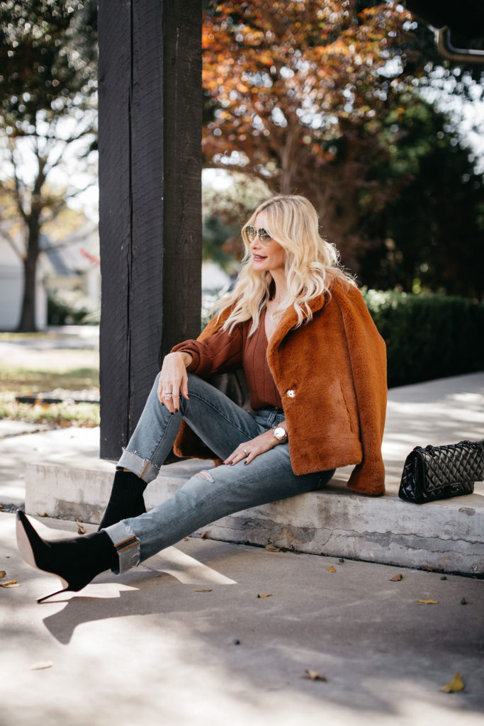 Dallas blogger wearing black heel booties and cuffed blue denim