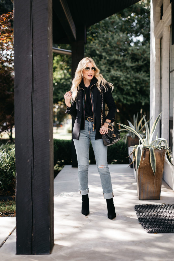 Dallas blogger wearing light wash denim and a black blazer
