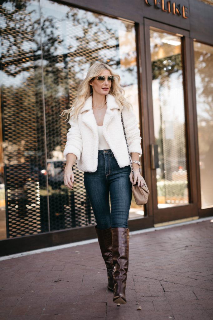 Dallas blogger wearing a white sweater and a white bodysuit with dark wash denim for fall and winter