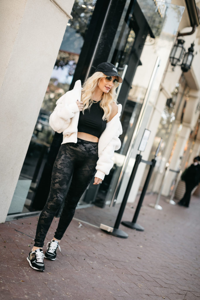 Dallas blogger wearing an affordable faux fur jacket and camo high-waist leggings