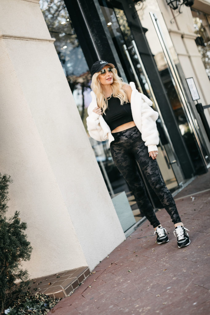 Dallas style blogger wearing Camo leggings by Spanx and Golden Goose sneakers