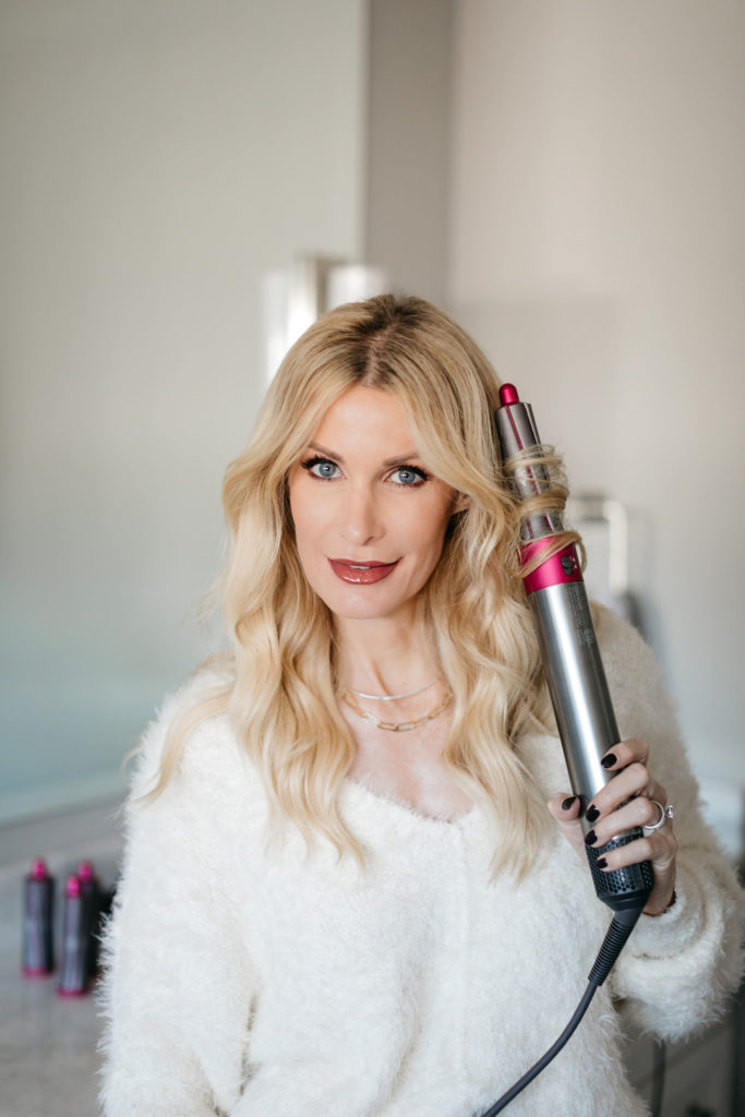 Style blogger wearing a cozy chic white sweater and curling iron by Dyson