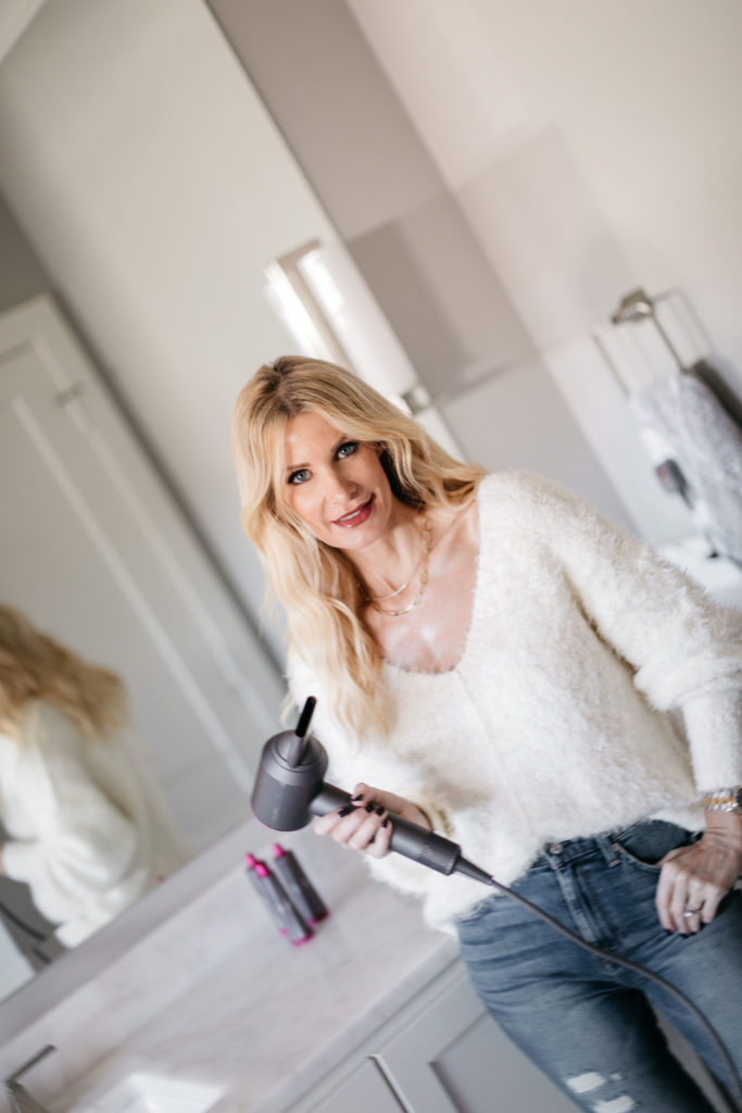 Dallas fashion blogger wearing a soft white v-neck sweater and using Dyson hair products