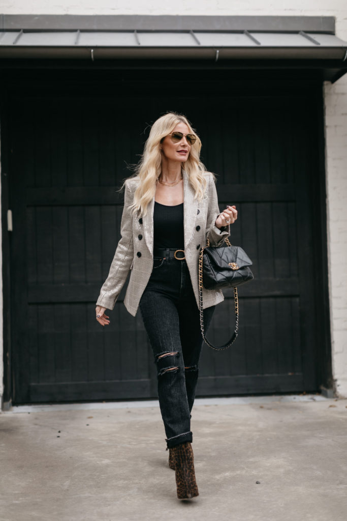 Dallas blogger wearing ripped black denim and a blazer for fall and winter 2020
