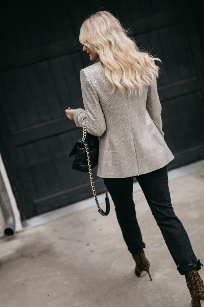Style blogger wearing a blazer by Veronica Beard for the holidays and black denim