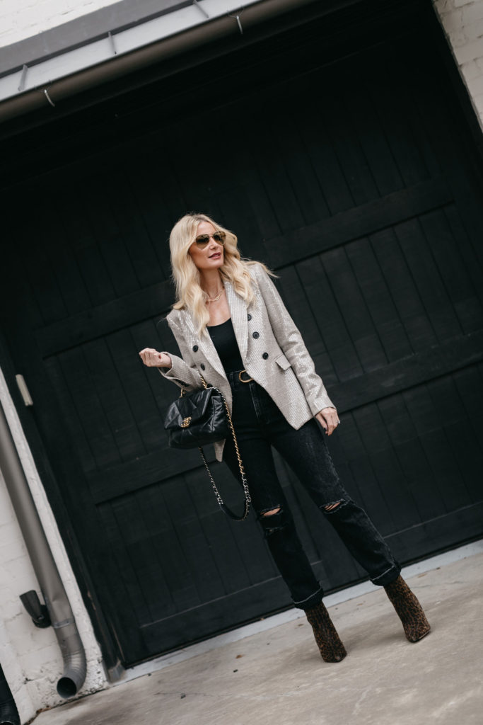 Dallas blogger wearing a blazer and faded black denim with a Chanel handbag