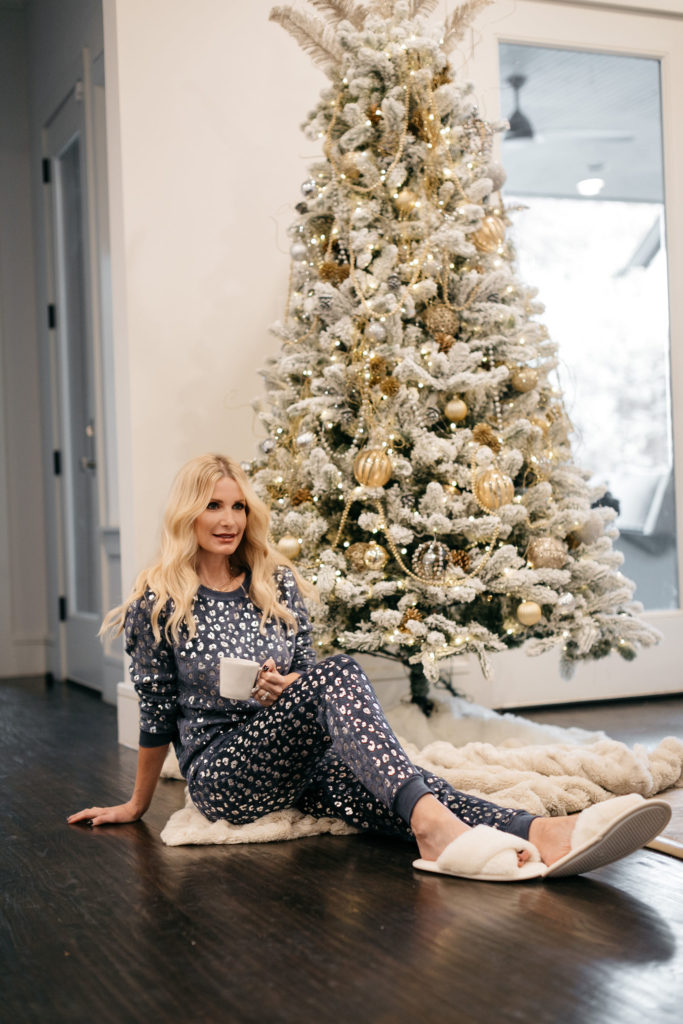 Dallas blogger wearing a leopard PJ set and white faux fur slippers