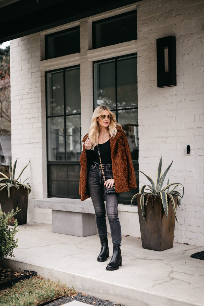 Dallas style blogger wearing faded black denim and a faux fur teddy coat