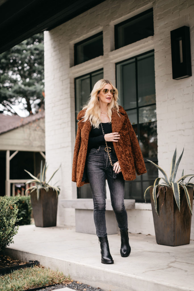 Dallas style blogger wearing a teddy coat and black denim