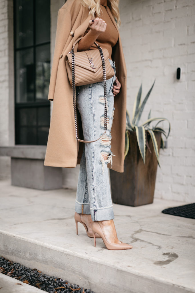 Dallas blogger wearing a neutral YSL bag and light wash ripped denim