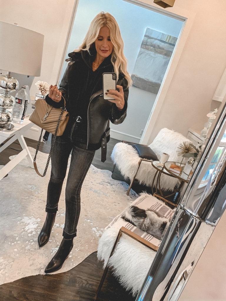 Dallas fashion blogger wearing a black coat and black denim