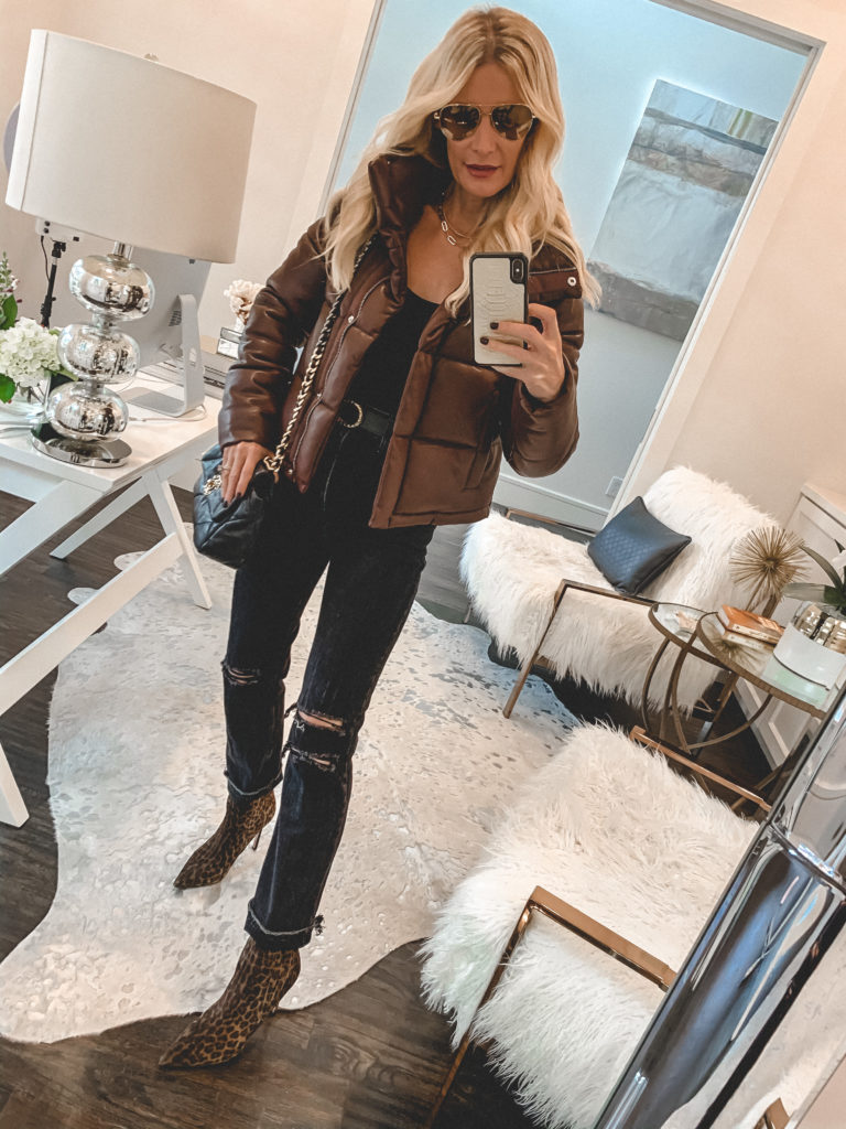 Dallas blogger wearing a brown puffer jacket and dark wash denim for fall and winter