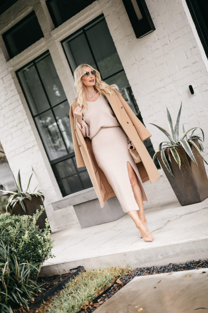 Dallas blogger wearing a camel colored coat and a neutral skirt