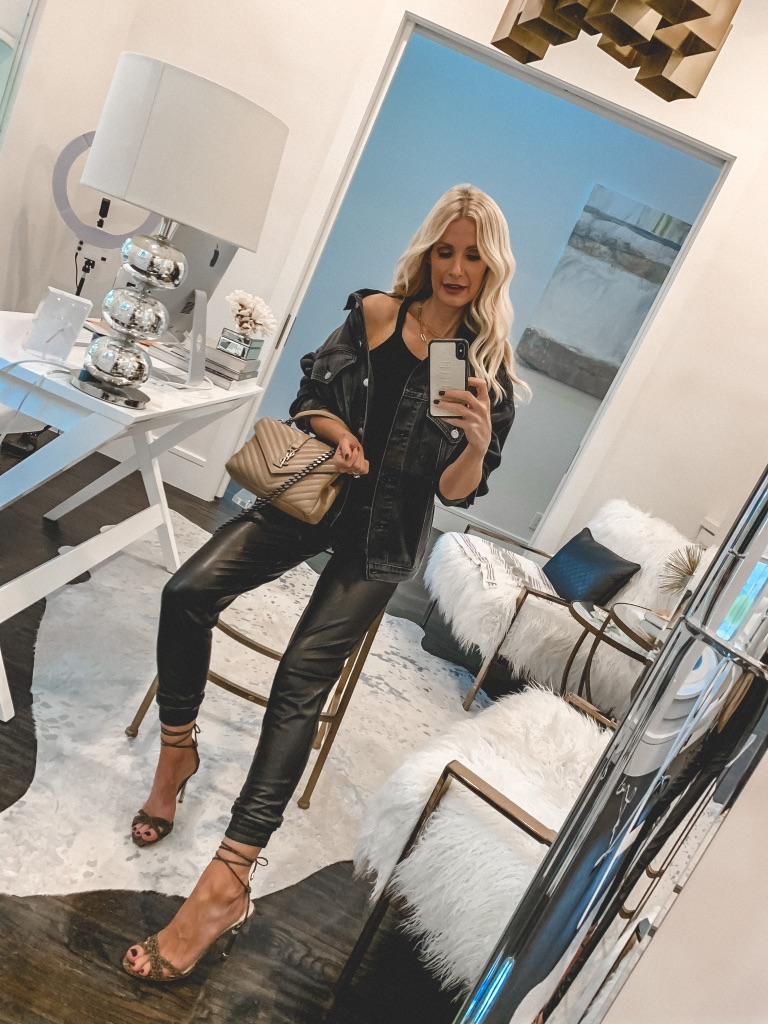 Dallas blogger wearing faux leather pants and a faded black denim jacket for fall