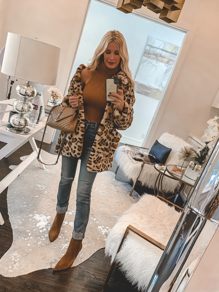 Dallas fashion blogger wearing a faux fur leopard print jacket and a turtleneck sweater