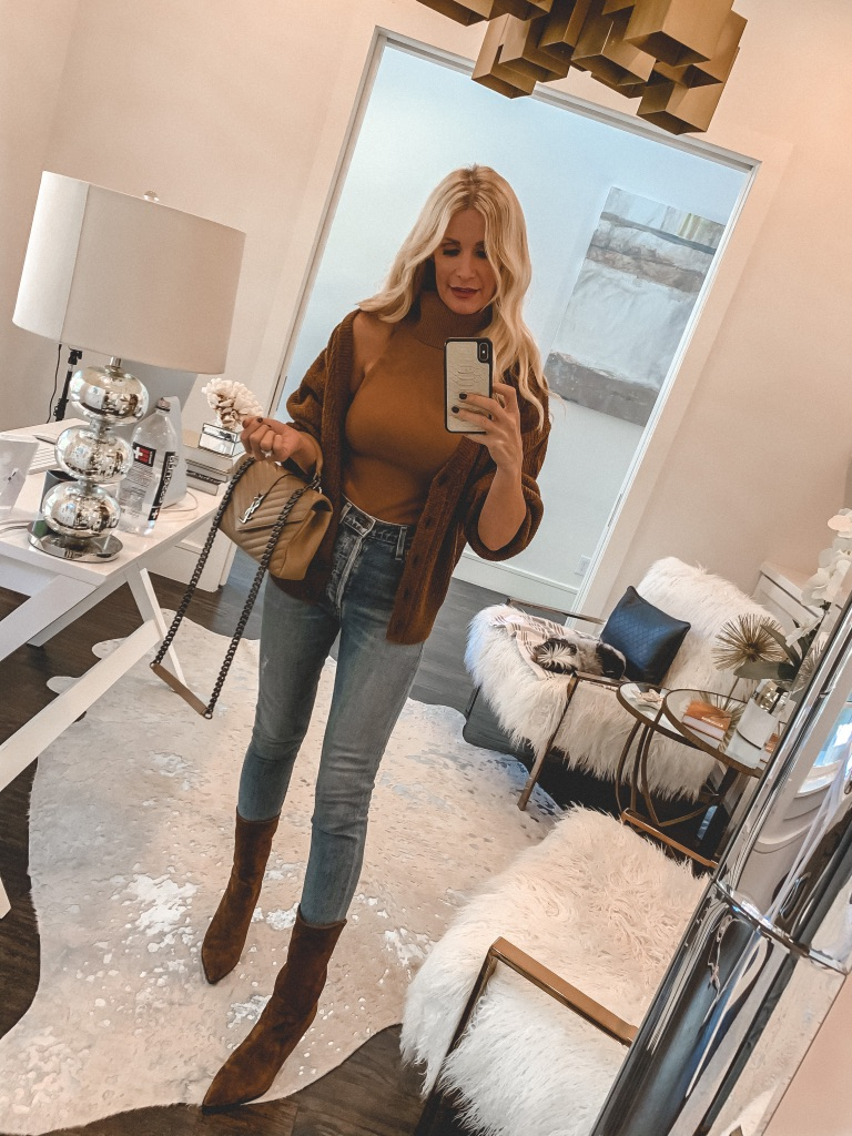 Style blogger wearing a rust brown cardigan with light wash denim and brown booties