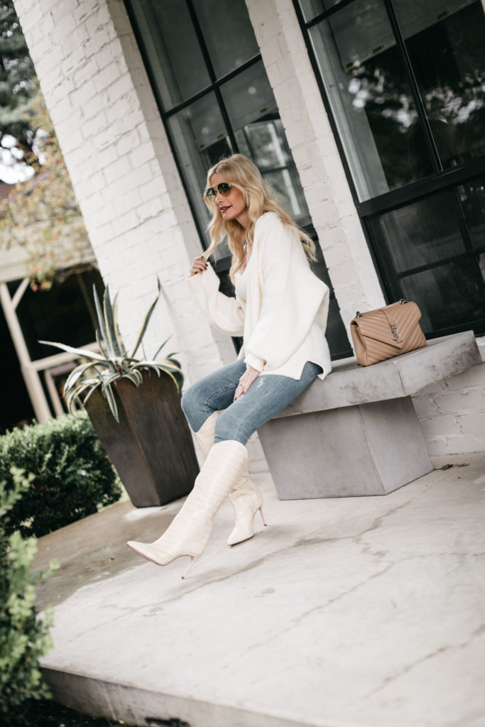 Style blogger wearing an all white fall and winter outfit featuring a super cozy chic cardigan