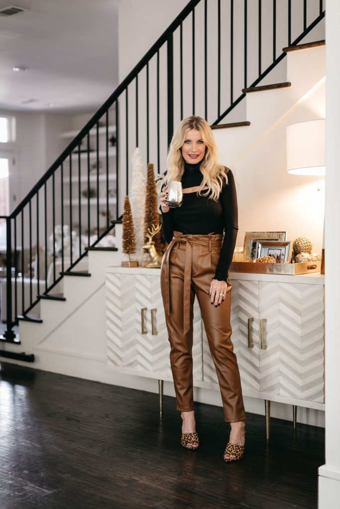 Dallas blogger wearing faux leather pants and a black long sleeve top