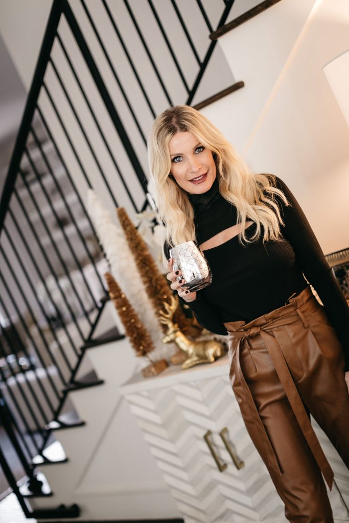 Dallas blogger wearing brown faux leather pants and a cut out black top from Bloomingdales