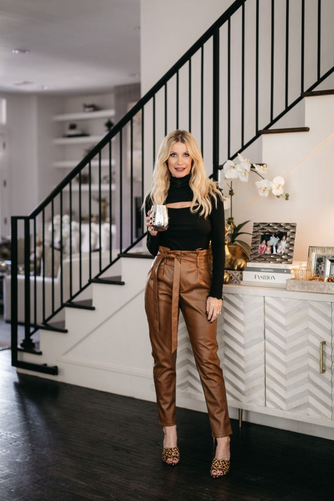 Dallas style blogger wearing brown faux leather pants and a black cut out top