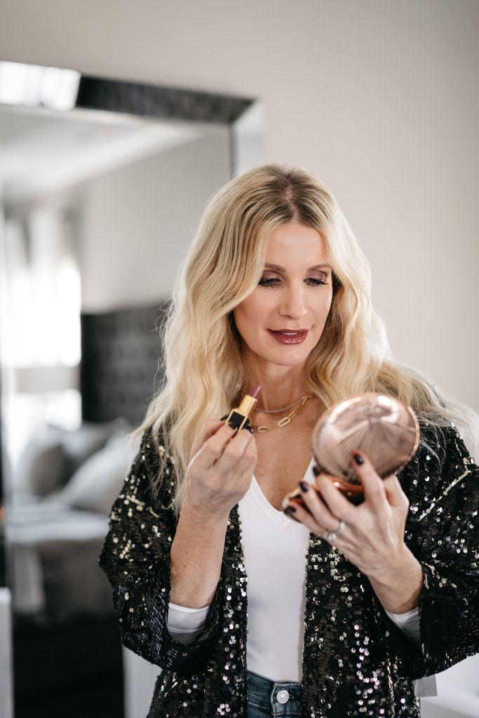 Dallas style influencer wearing Charlotte Tilbury makeup from Nordstrom and a black sequin jacket