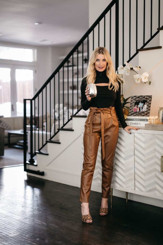 Dallas fashion blogger wearing faux leather pants and a black sweater