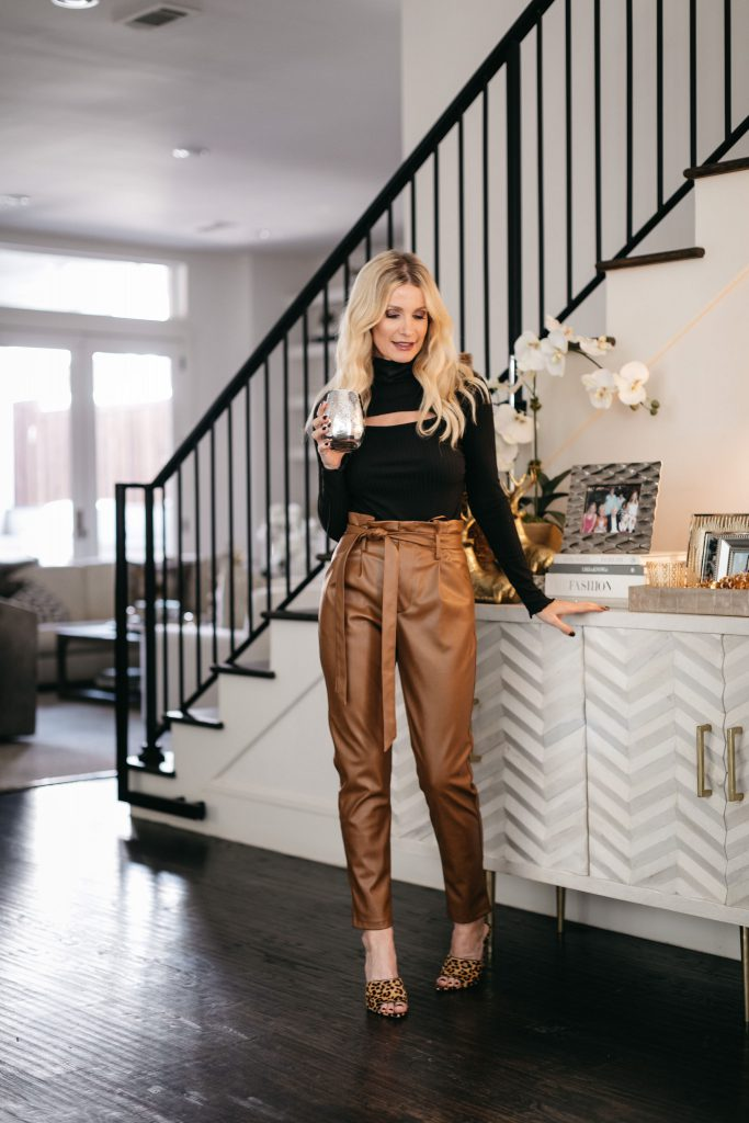 Style blogger sharing favorite home gifts from Bloomingdales and wearing faux leather pants