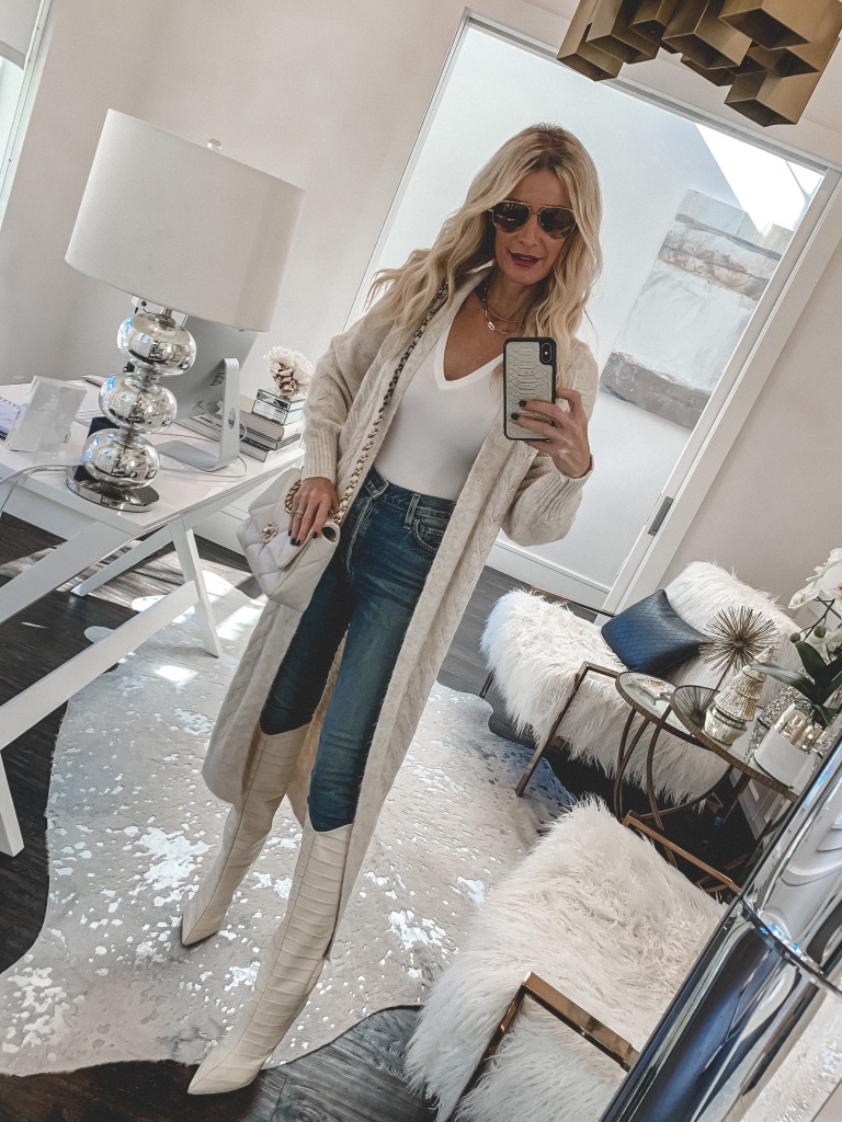 Dallas blogger wearing a long neutral cardigan and tall white boots