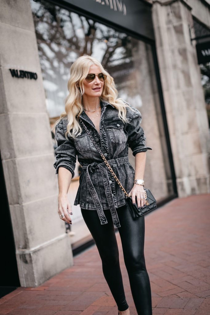 Dallas blogger wearing a black denim jacket and faux leather leggings