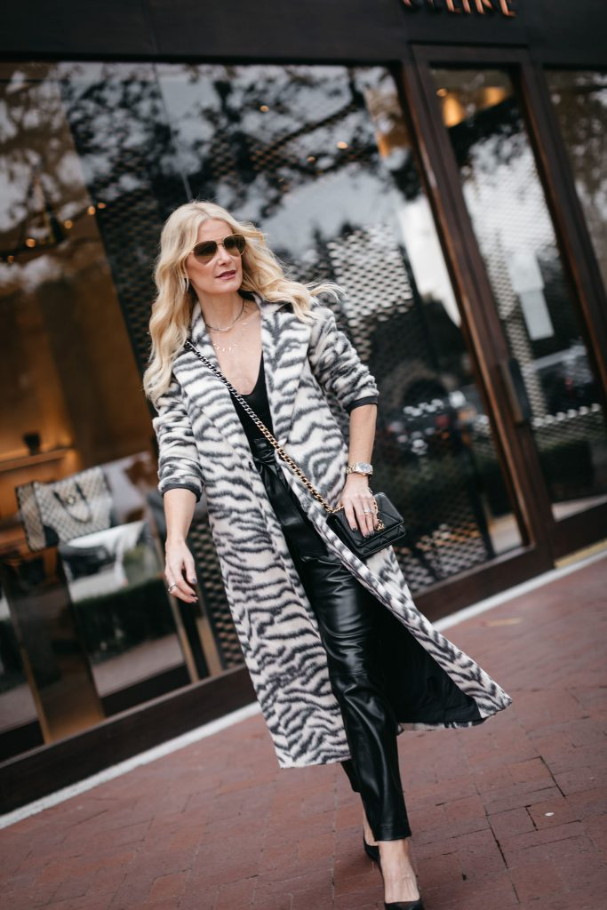 Dallas blogger wearing a long coat and faux leather pants