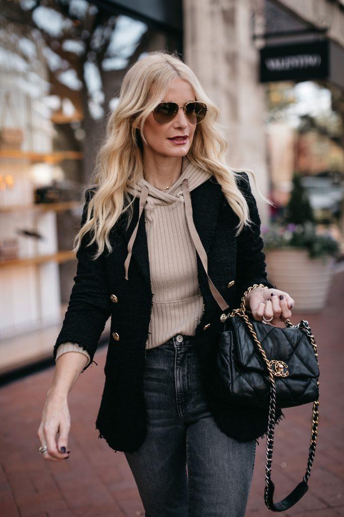 Dallas fashion blogger wearing a hoodie and blazer with black denim