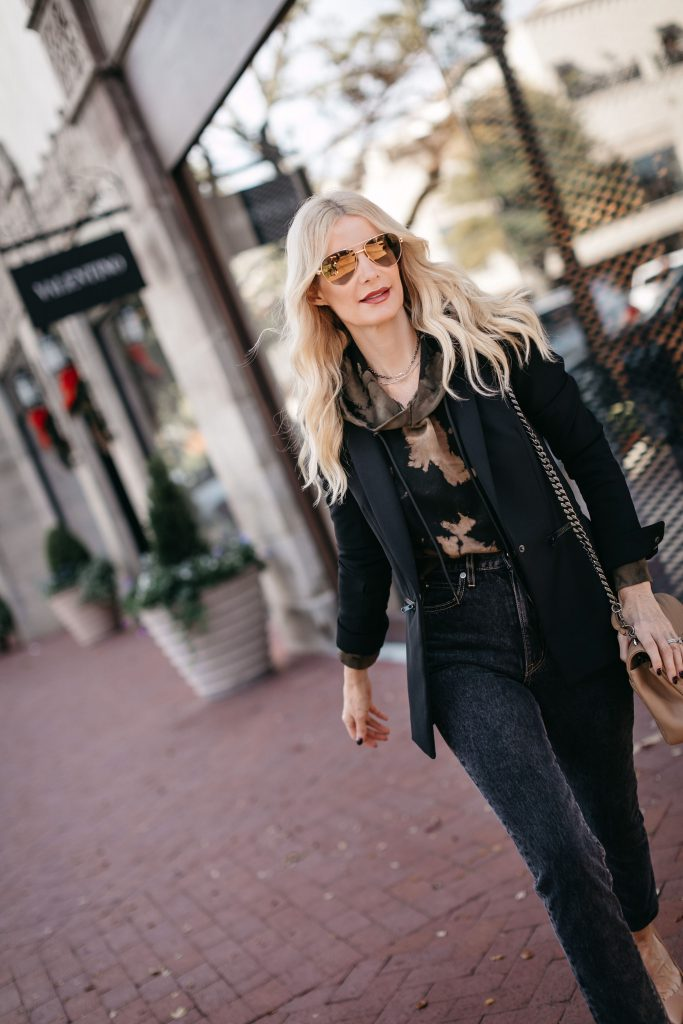 Dallas style blogger wearing a tie dye hoodie and a black blazer