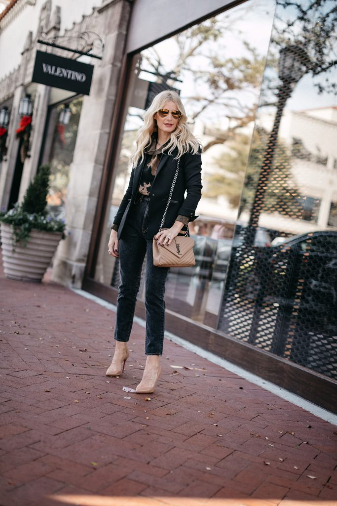 Style blogger wearing a black blazer and beige heels