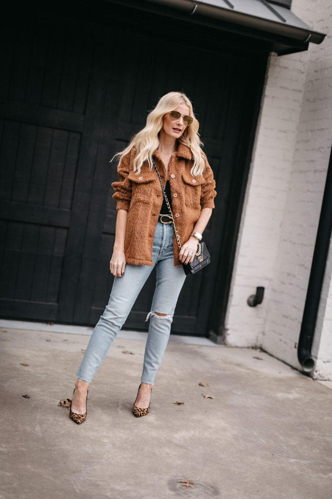 Dallas blogger wearing a brown teddy coat and light wash denim with cheetah heels