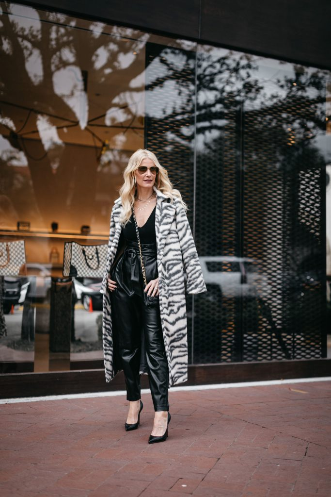 Dallas blogger wearing a black and white coat and faux leather pants