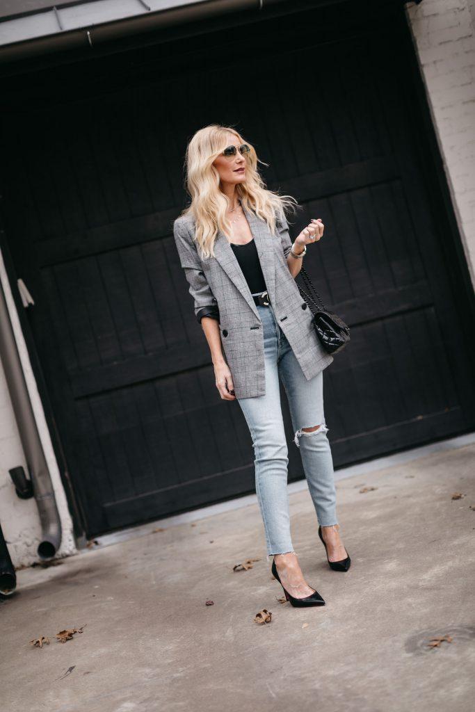 Dallas blogger wearing Redone light wash denim and a grey blazer