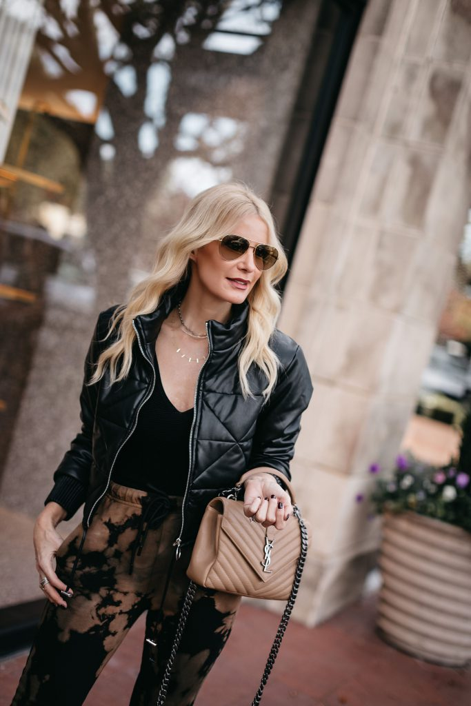 Style blogger wearing a bomber jacket and a black bodysuit